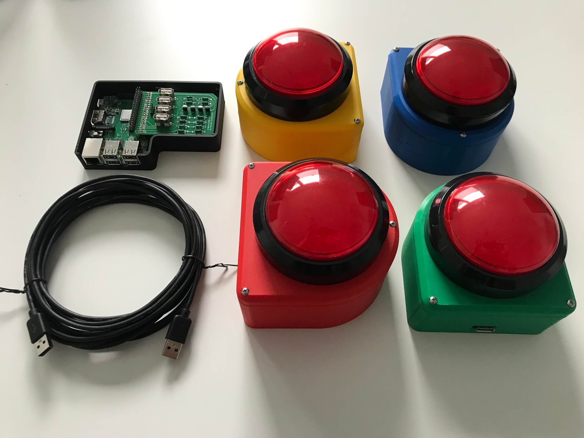things with buzzers: The final result - four game show buzzers, a raspberry pi, and a custom printed circuit board.