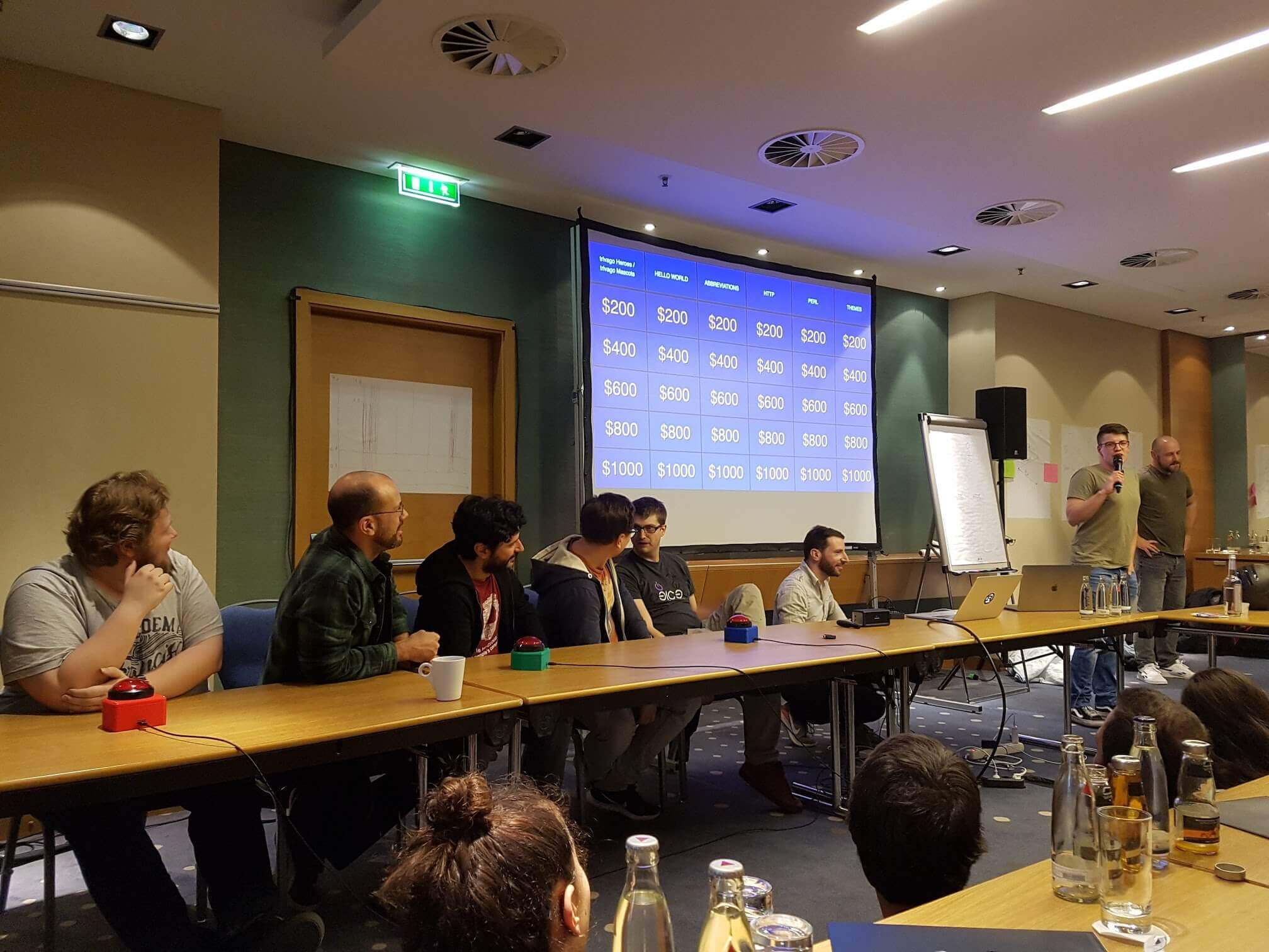 Playing a Jeopardy! game at trivago's internal tech conference on the 19th of March 2019 with our self-made game show buzzers.
